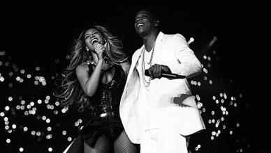 Beyonce and Jay Z are shown performing. (Credit: HBO)