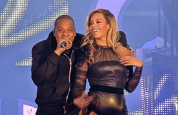 Jay Z and Beyonce are seen performing. (Credit: YouTube)