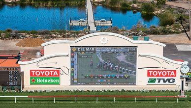 DEL MAR, CALIFORNIA - NOVEMBER 25, 2016: Tote board and pond of the Del Mar racetrack, the second largest horse racing venue in the western United States. (Credit: Shutterstock)