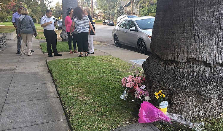 Friends gather outside the home where Vanessa Marquez was killed. (Credit: B. Higgs)