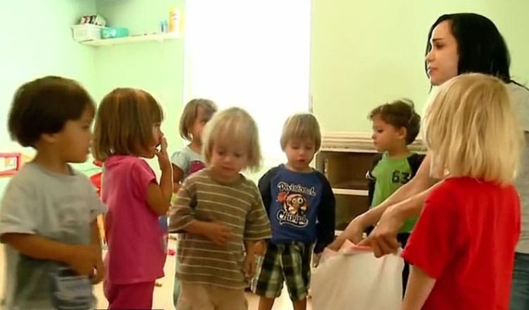 """Nadya Suleman is shown with seven of her children. (Credit: YouTube/""""Dr. Drew's Lifechangers"""")"""