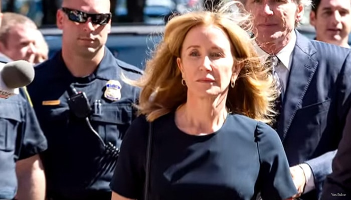 Felicity Huffman arrives at a Boston courtroom for her sentencing on April 13, 2019. (Credit: YouTube/ExtraTV)
