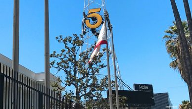 LOS ANGELES JULY 23, 2018: The American flag and California flag surround the iconic, 160-foot tall KTLA 5 radio tower on Sunset Boulevard on the Sunset Bronson Studios lot, first erected in 1925. (Credit: Shutterstock)