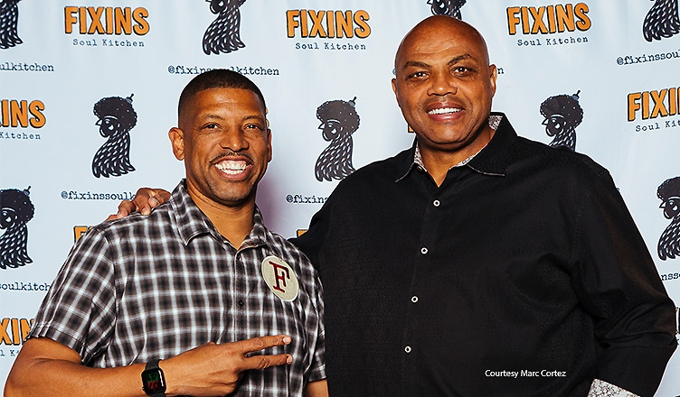 Kevin Johnson and Charles Barkley celebrate the grand opening of Fixins Soul Kitchen at L.A. LIVE on October 18, 2021 (Credit: Marc Cortez)